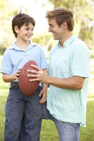 Father And Son Playing American Football Together Stock photo © monkey_business