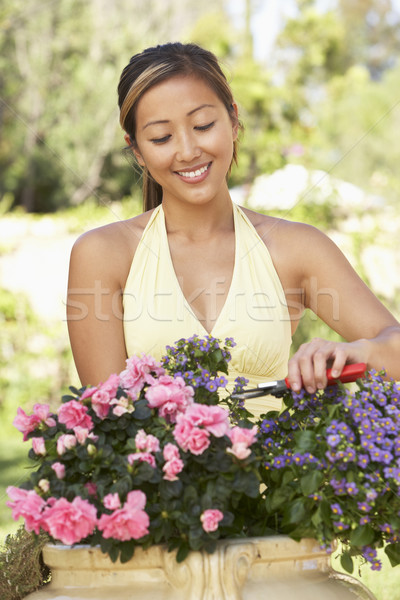 Young Woman Working In Garden Stock photo © monkey_business
