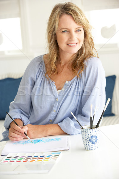 Mid age woman painting with watercolors Stock photo © monkey_business