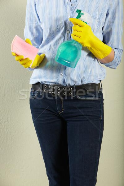 Lövés középkorú nő tart takarítószerek nő spray Stock fotó © monkey_business