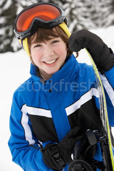 Młody chłopak snowboard narciarskie wakacje góry szczęśliwy Zdjęcia stock © monkey_business