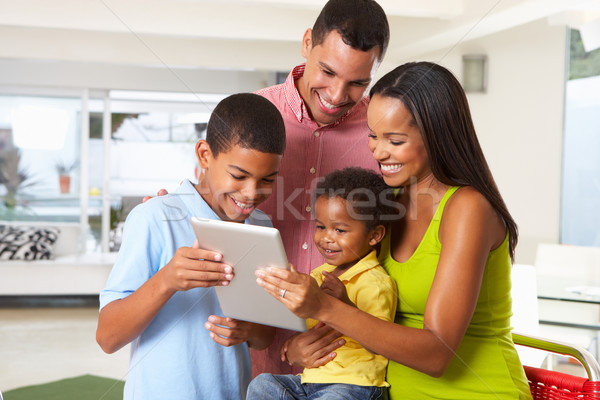 Family Using Digital Tablet In Kitchen Together Stock photo © monkey_business