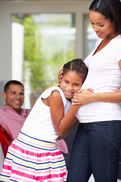 Lánygyermek hallgat terhes anyák gyomor család Stock fotó © monkey_business
