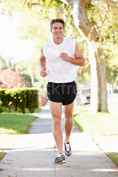Homme coureur banlieue rue hommes Photo stock © monkey_business