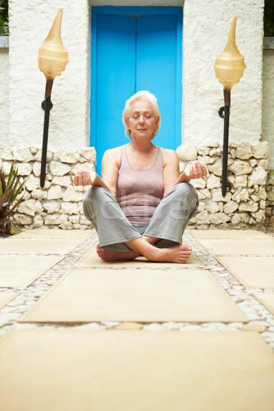 Senior Woman Meditating Outdoors At Health Spa Stock photo © monkey_business