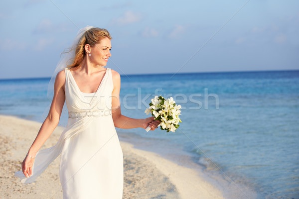 Stock photo: Beautiful Bride Getting Married In Beach Ceremony