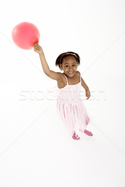 Young Girl Holding Party Balloon Stock photo © monkey_business