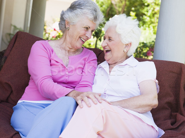 Stock photo: Senior female friends chatting together