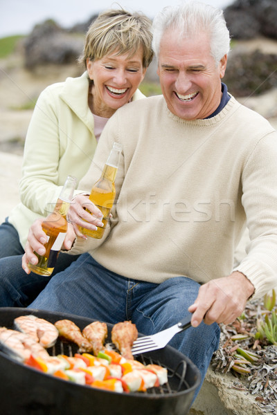 Couple Cooking On A Barbeque Stock photo © monkey_business
