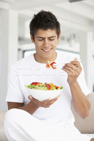 Young Man Eating A Salad Stock photo © monkey_business