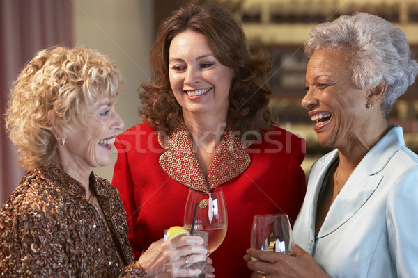 Friends Socializing At A Bar Stock photo © monkey_business