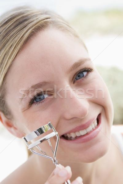 Woman with eyelash curler smiling Stock photo © monkey_business