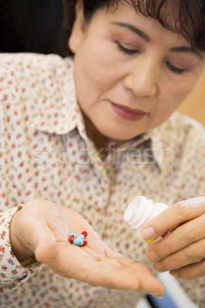Femme pilules santé médecine malade Photo stock © monkey_business