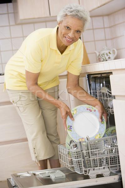 Woman Loading Dishwasher  Stock photo © monkey_business