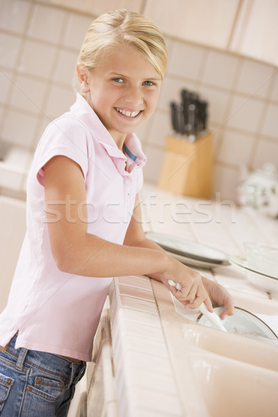Young Girl Cleaning Dishes,  Stock photo © monkey_business