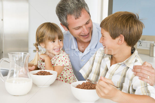 Father Sitting With Children As They Eat Breakfast  Stock photo © monkey_business