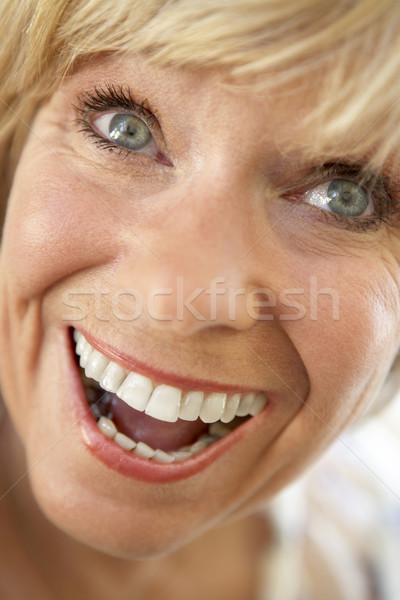 Middle Aged Woman Smiling Happily Stock photo © monkey_business