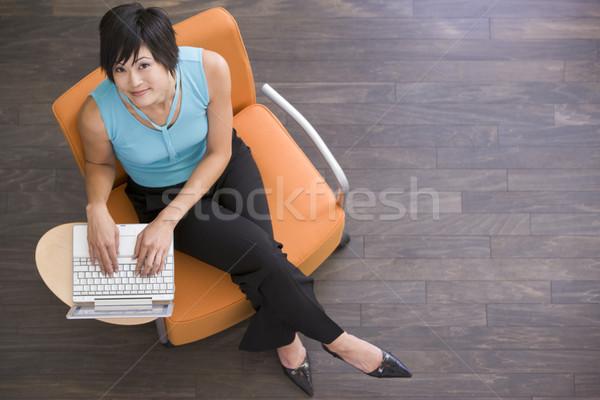 Stock fotó: üzletasszony · ül · bent · laptop · nő · munka
