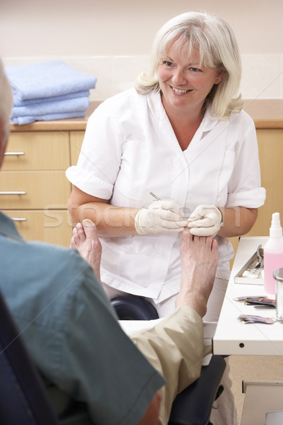 Chirpodist treating client in clinic Stock photo © monkey_business