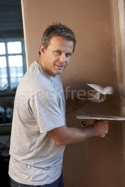 Werken interieur muur huis mannen werknemer Stockfoto © monkey_business
