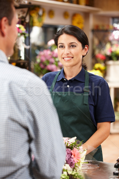 Woman serving customer in florist Stock photo © monkey_business
