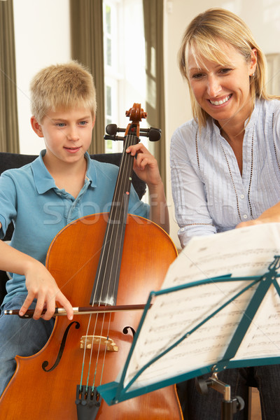 Boy playing cello in music lesson Stock photo © monkey_business