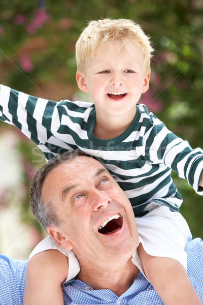 Grandfather Giving Grandson Ride On Shoulders Outdoors Stock photo © monkey_business