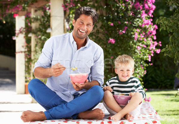 Father And Son Enjoying Breakfast Cereal Outdoors Together Stock photo © monkey_business