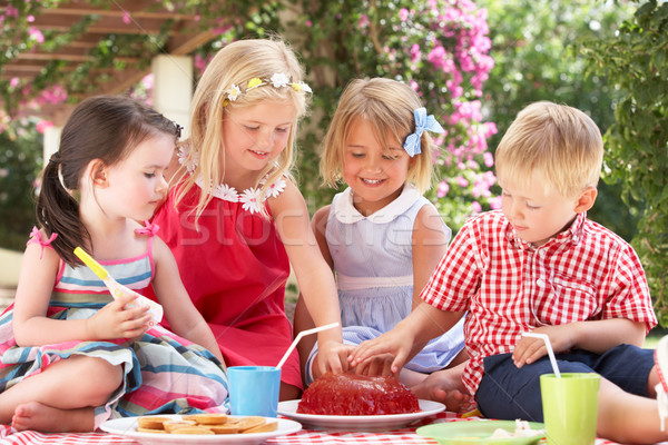 Group Of Children Eating Jelly At Outdoor Tea Party Stock photo © monkey_business