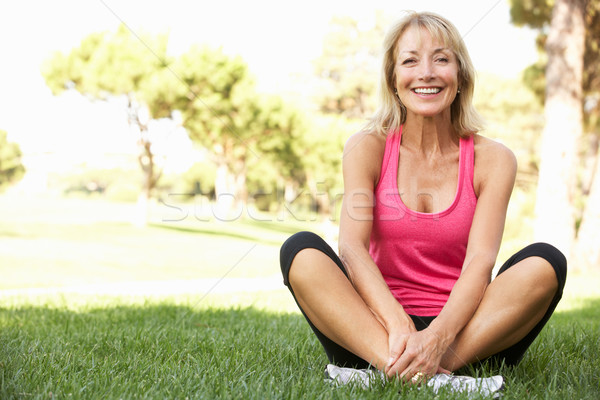 Senior Woman Resting After Exercising In Park Stock photo © monkey_business
