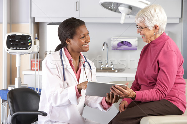 Stock photo: Doctor Discussing Records With Senior Female Patient