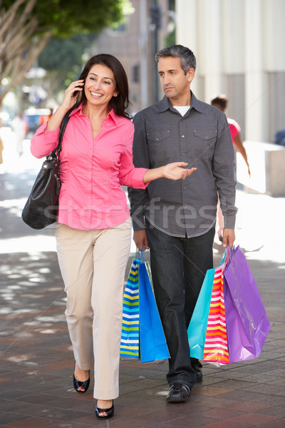 Fed Up Man Carrying Partners Shopping Bags On City Street Stock photo © monkey_business