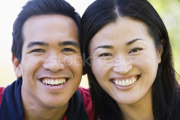 Pár kint mosolyog nő fű férfi Stock fotó © monkey_business