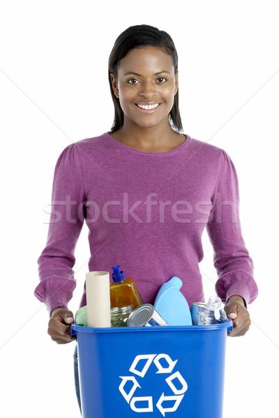 Stock photo: Woman Carrying Recycling Bin