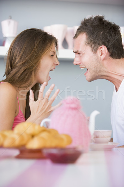 A young couple arguing at the breakfast table Stock photo © monkey_business