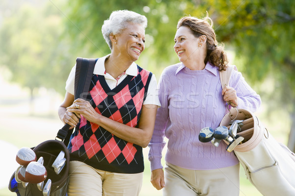 Homme amis jeu golf femmes Photo stock © monkey_business
