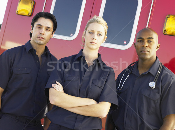 Portrait of paramedics standing in front of an ambulance Stock photo © monkey_business