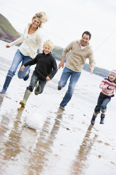 Family playing soccer at beach smiling Stock photo © monkey_business