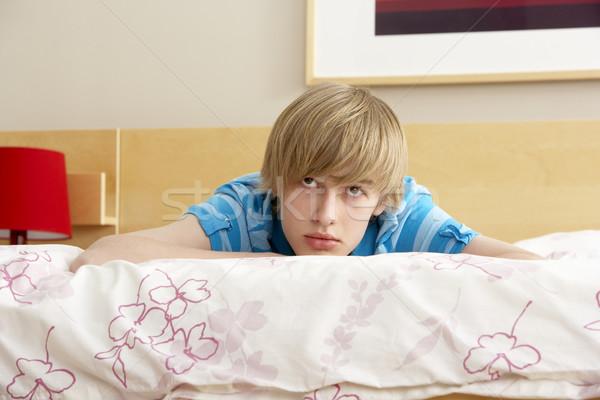 Teenage Boy In Bedroom Looking Sad Stock photo © monkey_business