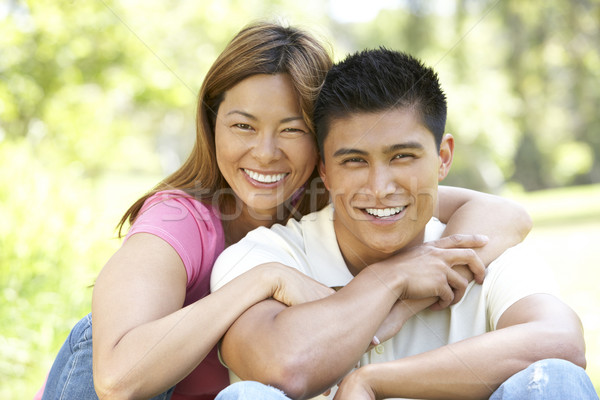 Stock photo: Portrait Of Young Couple Sitting In Park