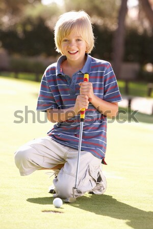 Young Girl Practising Golf On Putting On Green Stock photo © monkey_business