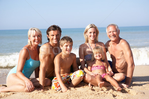 Three generation family pose on beach Stock photo © monkey_business