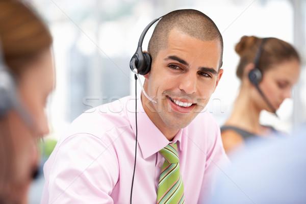 Genç işadamı kulaklık iş telefon Stok fotoğraf © monkey_business