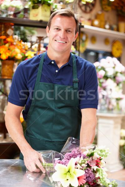 Mann arbeiten Blumengeschäft Blume Blumen Geschäftsmann Stock foto © monkey_business