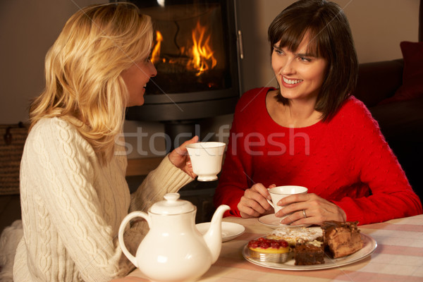 Two Middle Aged Women Enjoying Tea And Cake Together Stock photo © monkey_business