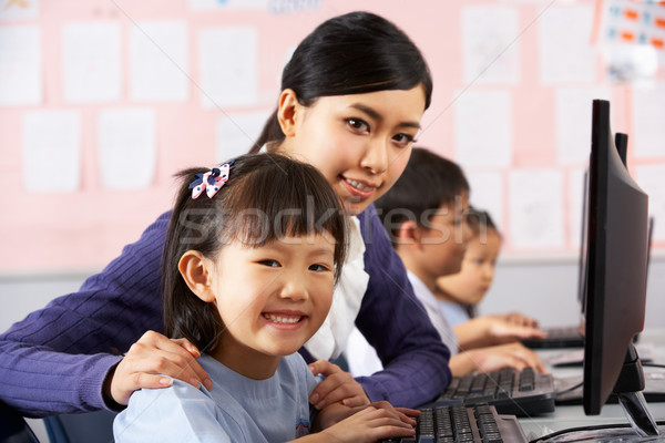 Stock fotó: Tanár · segít · diák · számítógép · osztály · kínai