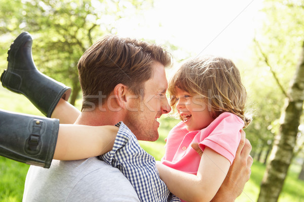 Father Playing Game With Son In Summer Field Stock photo © monkey_business