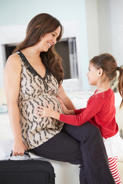 Daughter Greeting Pregnant Mother Home From Work Stock photo © monkey_business