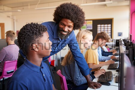 Elementary Students Working At Computers In Classroom Stock photo © monkey_business