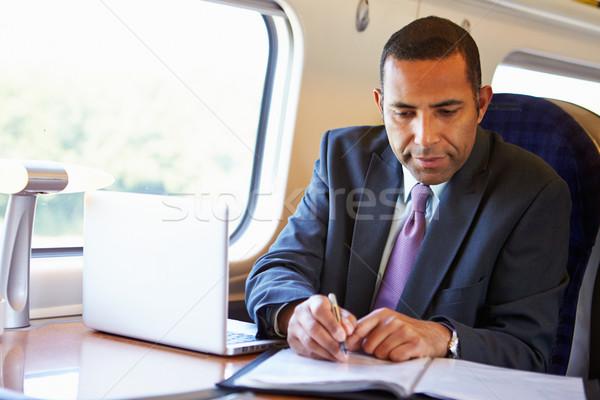 üzletember ingázás munka vonat laptopot használ férfi Stock fotó © monkey_business